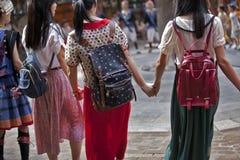Девушки рюкзака Стоковая Фотография