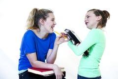 Девушки смеясь над на школе Стоковая Фотография RF