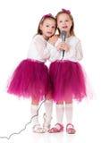 Девушки с микрофоном Стоковые Изображения
