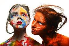 Девушки с покрашенными сторонами, искусством тела Стоковые Изображения