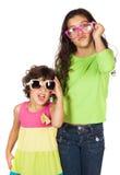 Девушки с солнечными очками стоковое фото rf
