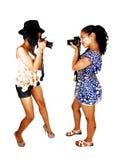 Девушки фотографируя. Стоковое Фото