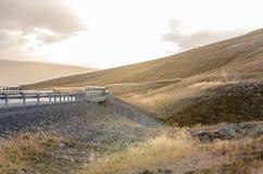 Дезертированная дорога на заходе солнца Стоковое Фото