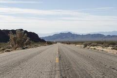 Дезертированная дорога в пустыне, США Стоковая Фотография RF