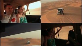Дезертируйте сафари SUVs bashing через аравийские песчанные дюны Девушка и парень в автомобиле 4 сток-видео