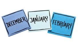 Декабрь, январь и февраль на липких примечаниях Стоковая Фотография