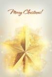 Декоративная желтая звезда для верхней части рождественской елки Стоковая Фотография