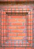 Декоративная рамка на кирпичной стене Стоковое Изображение RF