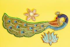 Декоративный красочный павлин с цветками стоковая фотография rf