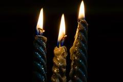 3 декоративных свечи в пламенах Стоковые Фотографии RF