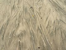 Делает по образцу текстуру песка на пляже стоковые фото