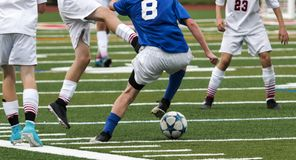 Делать движение во время игры футбола стоковая фотография