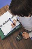 делать домашнюю работу стоковые фотографии rf