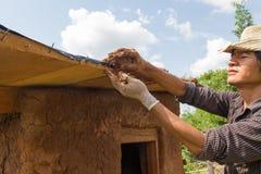 Делать крыши дома грязи Стоковое фото RF