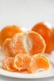 делит на сегменты tangerine Стоковое Изображение