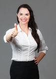 дело давая большие пальцы руки поднимает женщину Стоковое фото RF