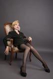 дело кресла сидит женщина костюма Стоковое Изображение RF