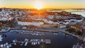 дел Восхитительный восход солнца над старым городком Faro Португалии Стоковые Фото