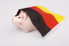 Денежный ящик и Германия свиньи сигнализируют - концепцию финансового кризиса Стоковое Фото