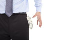Деньги бизнесмена хватая карманные Стоковое Изображение RF