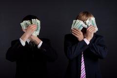 деньги бизнесменов Стоковые Фото