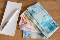 Деньги Бразилии/reais/концепция семейного бюджета Стоковые Фотографии RF