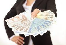 Деньги взяткой предпринимателя предлагая стоковые фото