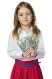 Деньги владением девушки ребенка в изолированных руках Стоковая Фотография