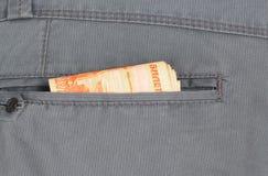 Деньги в карманн ваших брюк стоковые изображения