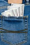 Деньги в карманн голубого демикотона 100 долларовых банкнот в демикотоне p Стоковые Изображения