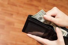 Деньги в конце бумажника вверх стоковая фотография rf