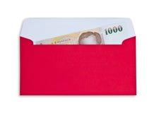 Деньги в красном габарите Стоковые Изображения