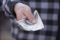 Деньги в руке Стоковое Изображение RF