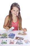 деньги девушки Стоковая Фотография RF