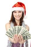 деньги девушки claus предлагают santa Стоковые Фото