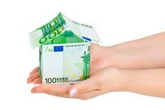 деньги дома рук Стоковое Изображение