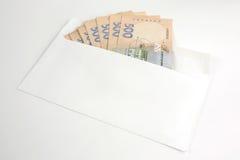 Деньги евро в белом конверте Стоковые Изображения RF