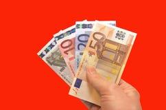 Деньги евро в руке Стоковая Фотография