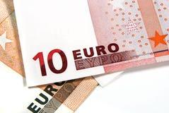 Деньги евро на белой предпосылке Стоковое фото RF