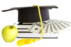Деньги и книги для школы Стоковые Изображения