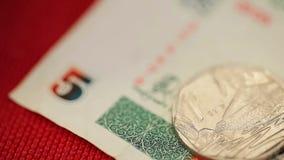 Деньги и монетка Cubana сток-видео