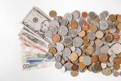 Деньги и монетки мира стоковое фото rf