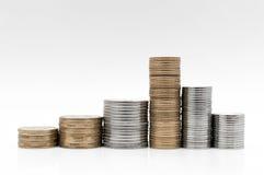 Деньги и монетки на белой поверхности Стоковая Фотография RF