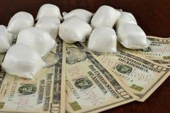 Деньги и порошок Стоковая Фотография RF