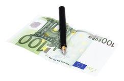 Деньги и ручка Стоковые Фотографии RF