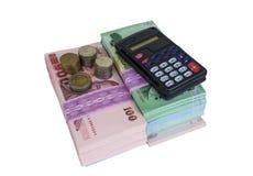 Деньги и чалькулятор стоковые фотографии rf