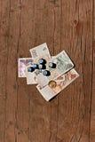 Деньги и dices Стоковые Изображения