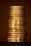 деньги колонки золотистые Стоковые Изображения RF