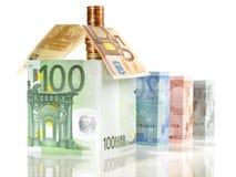 Деньги - концепция недвижимости с банкнотами стоковая фотография