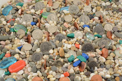 Деньги металла на камне Стоковое фото RF